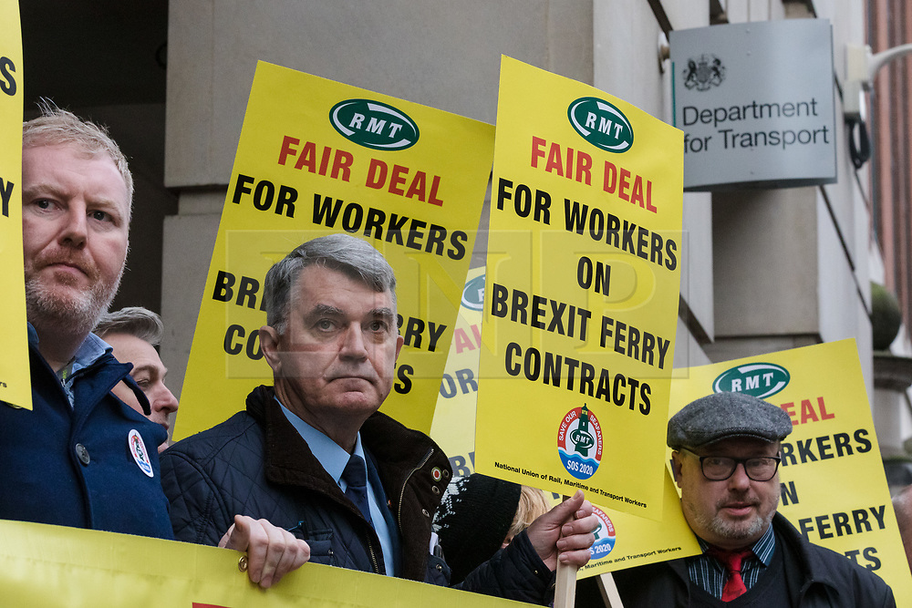 © Licensed to London News Pictures. 11/01/2019. London, UK.  Members of the National Union of Rail, Maritime and Transport Workers (RMT) joined by General Secretary, Mick Cash (centre) stage a protest outside the Department for Transport to call for Transport secretary, Chris Grayling  provides a fair deal for workers on Brexit ferry contracts, including demands that new cross Channel ferries to be crewed by UK workers, the recognition of UK trade unions and full compliance with UK employment laws. The protest follows a no-deal Brexit contract awarded by the government to Seaborne Freight and the ongoing dredging of Ramsgate Harbour.  Photo credit: Vickie Flores/LNP