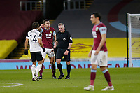 Football - 2020 / 2021 Premier League - Burnley vs. Fulham<br /> <br /> referee Jonathan Moss has words with James Tarkowski of Burnley and Bobby Reid of Fulham, at Turf Moor.<br /> <br /> <br /> COLORSPORT/ALAN MARTIN