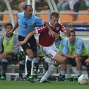 Uruguay's Mendes and Denmark's Jesper Gronkjaer