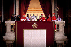VATICAN CITY, VATICAN - MARCH 13, 2013 - Argentinian Cardinal Jorge Mario Bergoglio was later elected as the 266th Pontiff. Hundreds of faithful in St Peter's Square waiting for the outcome of the voting in the conclave. Newly elected Pope Francis I appears on the central balcony of ST Peter's Basilica. Photo Giovanni Marino/Inside......