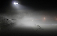 Middletown, NY - Fog rolls across the football field, track and bleachers at Faller Field on the evening of Nov. 15, 2009.