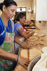 Gujerati women cook lunch for a community event; Bradford,