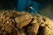 Diver exploring the world war 2 Japanese wreck of the Shinwa Maru, Manokwari, West Papua