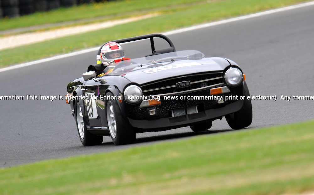 Graeme Rutledge - Triumph TR6.Historic Motorsport Racing - Phillip Island Classic.18th March 2011.Phillip Island Racetrack, Phillip Island, Victoria.(C) Joel Strickland Photographics.Use information: This image is intended for Editorial use only (e.g. news or commentary, print or electronic). Any commercial or promotional use requires additional clearance.