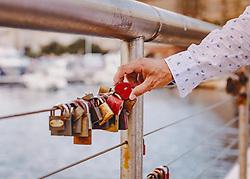 THEMENBILD - ein Mann hält ein Schloss in Herzform in den Händen. Am Hafen hängen viele Schlösser am Brückengeländer, die Paare als Zeichen ihrer Liebe angebracht haben, aufgenommen am 13. August 2019 in Rijeka, Kroatien // a man holds a heart-shaped lock in his hands. At the harbour there are many locks hanging from the railing of the bridge, which couples have attached as a sign of their love, in Rijeka, Croatia on 2019/08/13. EXPA Pictures © 2019, PhotoCredit: EXPA/Stefanie Oberhauser