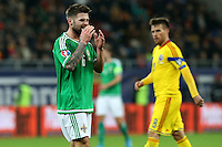 ROMANIA, Bucharest: Northern Ireland's Oliver Norwood (L) is disappointed during the Euro 2016 Group F qualifying football match Romania vs Northern Ireland in Bucharest, Romania on November 14, 2014.