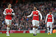 Francis Coquelin of Arsenal talking to Laurent Koscielny of Arsenal. The Emirates FA cup, 4th round match, Arsenal v Burnley at the Emirates Stadium in London on Saturday 30th January 2016.<br /> pic by John Patrick Fletcher, Andrew Orchard sports photography.