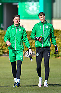 Kevin Dabrowski (#21) of Hibernian FC and Matt Macey (#33) of Hibernian FC make their way to the pitches during the training session for Hibernian FC at the Hibernian Training Centre, Ormiston, Scotland on 9 April 2021, ahead of their SPFL Premiership match with Rangers.