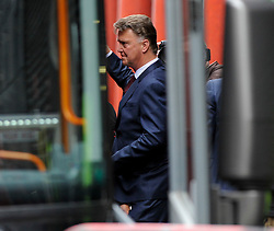 © Licensed to London News Pictures. 21/05/2016. London, UK. Manager, Louis Van Gaal boards the bus. Fans and supporters gather outside the Hilton hotel near Wembley Stadium to see the players of Manchester United board the team bus for the short journey to Wembley Stadium ahead of the FA Cup Final against Crystal Palace. Photo credit : Stephen Chung/LNP