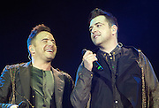 """Westlife Farewell Tour 2012 at the SECC.27-05-12...Shane Filan &  Mark Feehily, of Irish Super Group Westlife perform during their sell out show at the SECC in the Scottish Leg of their Farewell World Tour. ..Westlife are an Irish boy band formed in 1998. They are to disband in 2012 after their farewell tour. The group's line-up was Shane Filan, Mark Feehily, Kian Egan, and Nicky Byrne. Brian McFadden was part of the group until 2004. Westlife have sold over 45 million records worldwide which includes studio albums, singles, video release, and compilation albums.. Despite the group's worldwide success, they only have one hit single in the United States, """"Swear It Again"""", which peaked in 2000 on the Billboard Hot 100 at number 20. The band were originally signed by Simon Cowell and are managed by Louis Walsh. The group have accumulated 14 number-one singles in the United Kingdom, the third-highest in UK history, tying with Cliff Richard..The group had also broken a few records, including """"Music artist with most consecutive number 1's in the UK"""", which consists of their first seven singles and only behind The Beatles and Elvis Presley..The band have 14 UK number ones and 25 top ten singles, consisting of 20.2 million records and videos in the UK across their 14-year career - 6.8 million singles, 11.9 million albums and 1.5 million videos. The Band are best known for amazing songs such as Flying Without Wings and Safe....At The SECC, Glasgow..Picture  Mark Davison/ ProLens PhotoAgency/ PLPA.Sunday 27th May 2012."""