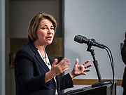 "15 JULY 2019 - DES MOINES, IOWA: Senator AMY KLOBUCHAR (D-MN) answers reporters' questions in the ""press gaggle"" room after her presentation at the first AARP Presidential Candidate Forum in Des Moines. The forum featured Senator Cory Booker, Governor John Hickenlooper, Senator Amy Klobuchar and Vice President Joe Biden. The AARP is hosting other forums for the rest of the Democratic field in other towns in Iowa this week. Iowa hosts the first event of the 2020 Presidential election cycle. The Iowa Caucuses are on February 3, 2020.       PHOTO BY JACK KURTZ"