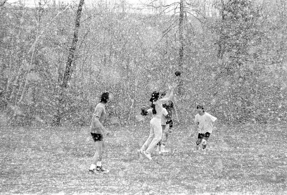 Jefferson High School students play football in their gym class in the middle of a sudden snowstorm, Wednesday, Nov. 5, 1986 in Jefferson, N.J. (D. Ross Cameron/North Jersey Advance)