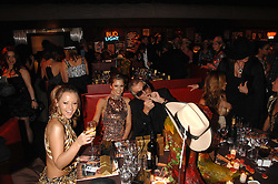 Left to right, KIMBERLEY WALSH, CHERYL COLE and ROBERTO CAVALLI at the London Red Cross Ball themed 'Honky Tonk Blues' held at 99 Upper Ground, London SE1 on 21st November 2007.<br />