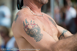 Eric Walker of New Smyrna Beach, FL with a Harley-Davidson Evo motor tattoo at the Cabbage Patch during Daytona Beach Bike Week. FL, USA. Wednesday, March 11, 2015.  Photography ©2015 Michael Lichter.