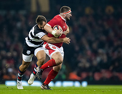 Wyn Jones of Wales is tackled by Andre Esterhuizen of Barbarians <br /> <br /> Photographer Simon King/Replay Images<br /> <br /> Friendly - Wales v Barbarians - Saturday 30th November 2019 - Principality Stadium - Cardiff<br /> <br /> World Copyright © Replay Images . All rights reserved. info@replayimages.co.uk - http://replayimages.co.uk