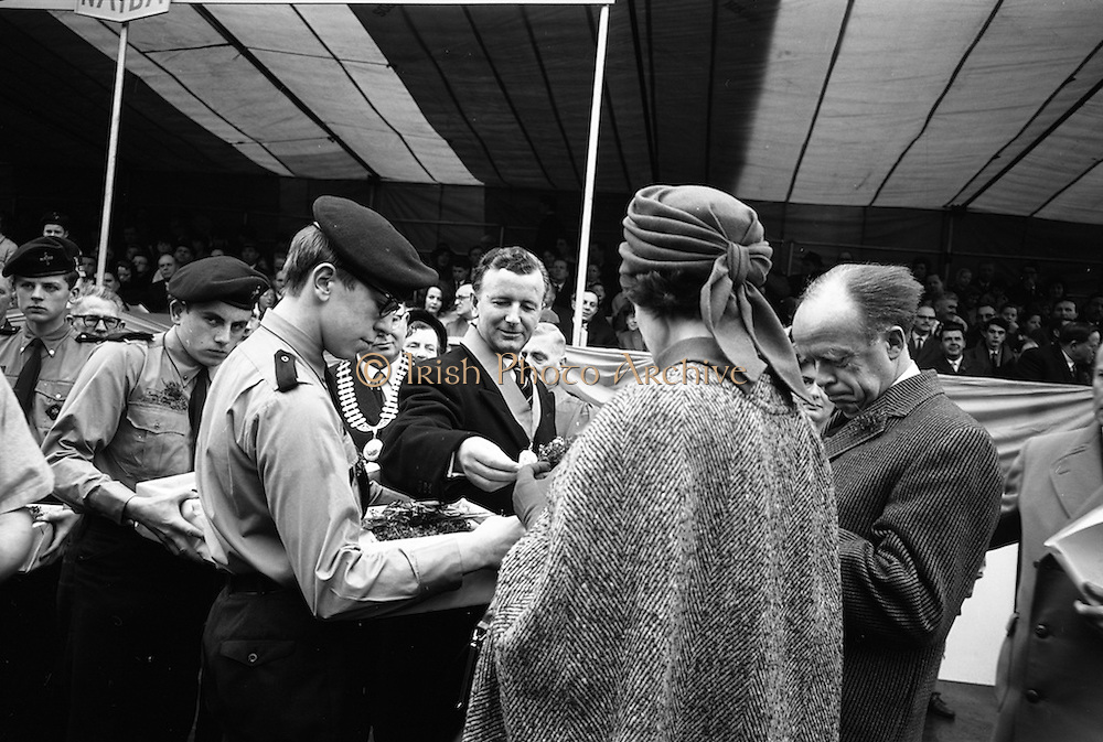 17/03/1965<br /> 03/17/1965<br /> 17 March 1965<br /> NAIDA St. Patrick's Day Parade, Dublin. Shamrock being distributed to distinguished guests, including Minister of Transport and Power, Erskine Childers on left, by Scouts outside the GPO on O'Connell Street.