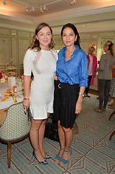 Left to right, ZENOUSKA MOWATT and YASMIN MILLS at a breakfast hosted by Halcyon Days at Fortnum & Mason, 181 Piccadilly, London on 8th July 2014.