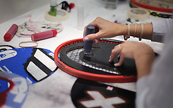 A branding logo is applied to a racket in the Stringing Room on day two of the Wimbledon Championships at the All England Lawn Tennis and Croquet Club, Wimbledon. PRESS ASSOCIATION Photo. Picture date: Tuesday July 4, 2017. See PA story TENNIS Wimbledon. Photo credit should read: Philip Toscano/PA Wire. RESTRICTIONS: Editorial use only. No commercial use without prior written consent of the AELTC. Still image use only - no moving images to emulate broadcast. No superimposing or removal of sponsor/ad logos.