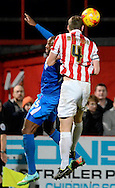 Captain Matt taylor wins a header during the Sky Bet League 2 match between Cheltenham Town and Portsmouth at Whaddon Road, Cheltenham, England on 20 December 2014. Photo by Alan Franklin.