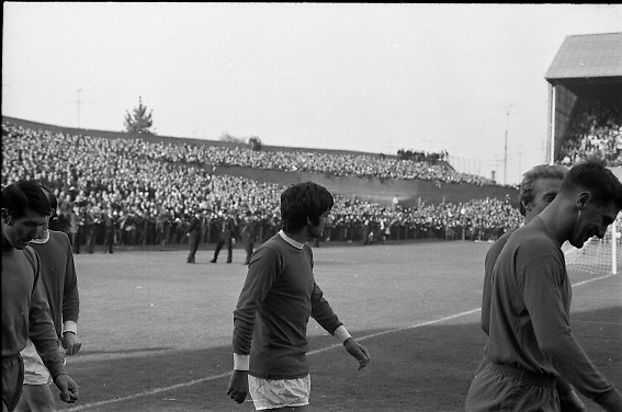 Waterford FC vs Manchester United at Lansdowne Road..1968..18.09.1968..09.18.1968..18th September 1968..Waterford FC as champions of the league of Ireland drew Manchester United, the European Champions,in the first round of this years competition.The Waterford team was as follows: Peter Thomas, Peter Bryan, Noel Griffin, Vinny Maguire, Jackie Morley, Jimmy McGeough, Al Casey, Alfie Hale, John O'Neill, Shamie Coad and Johnny Matthews. Manchester United won the tie 3 -1 with Denis Law being the man of the match..Alex Stepney,Tony Dunne,Francis Burns,Paddy Crerand,.Bill Foulkes,Nobby Stiles,George Best,Denis Law,.Bobby Charlton,David Sadler,Brian Kidd were the starting eleven for United...Image shows George Best taking in the scene at Lansdowne Road.