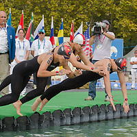 Members of team China compete during the Youth Team 3 km competition of the FINA World Junior Open Water Swimming Championships in Balatonfured (about 132 km South-West from capital city Budapest), Hungary on September 07, 2014. ATTILA VOLGYI