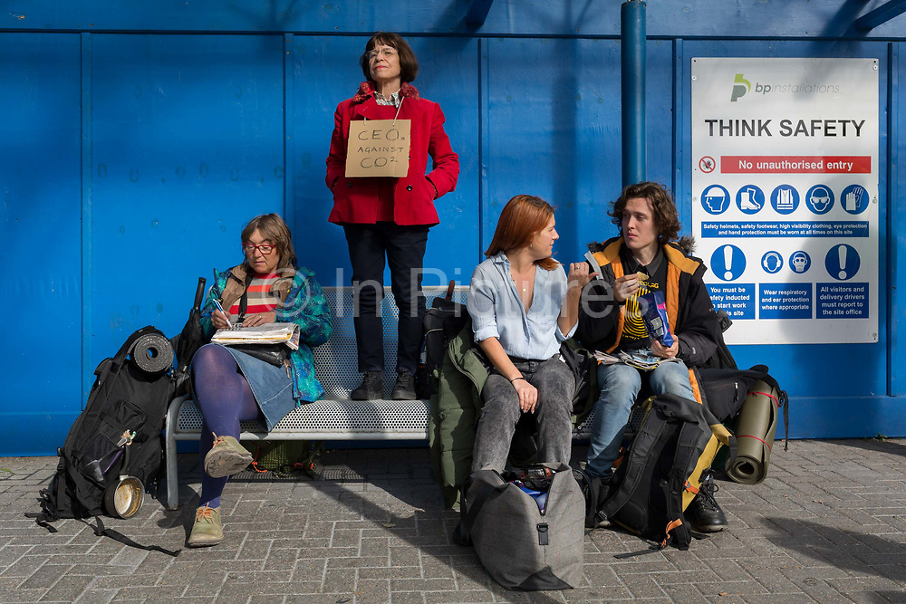 Passengers are disrupted outside the terminal building as environmental activists protest about Climate Change during the occupation of City Airport Londons Business Travel hub in east London, the fourth day of a two-week prolonged worldwide protest by members of Extinction Rebellion, on 10th October 2019, in London, England.