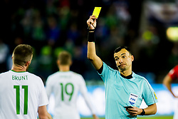 October 8, 2017 - Oslo, NORWAY - 171008 Chris Brunt of Northern Ireland is shown the yellow card by the referee Serhiy Boiko of Ukraine during the FIFA World Cup Qualifier match between Norway and Northern Ireland on October 8, 2017 in Oslo..Photo: Fredrik Varfjell / BILDBYRN / kod FV / 150028 (Credit Image: © Fredrik Varfjell/Bildbyran via ZUMA Wire)