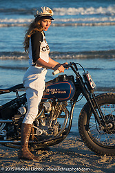 Brittney Olsen on her One of One Harley-Davidson posing for painter David Uhl at The Race of Gentlemen. Wildwood, NJ, USA. October 11, 2015.  Photography ©2015 Michael Lichter.