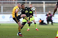Dan Butler of Newport County is challenged by Jevani Brown of Cambridge Utd (r). The Emirates FA Cup, 2nd round match, Newport County v Cambridge United at Rodney Parade in Newport, South Wales on Sunday 3rd December 2017.<br /> pic by Andrew Orchard,  Andrew Orchard sports photography.