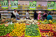 Supermarkets are generally a new phenomenon in Ecuador as the large outdoor markets have long been a way of life for Ecuadorians. Though they still exist, supermarkets have begun to replace them in the bigger cities. Quito, Ecuador. (Supporting image from the project Hungry Planet: What the World Eats)