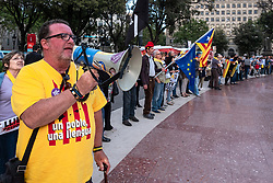 April 27, 2018 - Barcelona, Catalonia, Spain - A pro independence of catalonia protester seen singing slogans with a megaphone. A hundred people have recalled that Catalan political prisoners have been in prison for 1050 days lighting the same number of candles in the Plaza Catalunya in Barcelona (Credit Image: © Paco Freire/SOPA Images via ZUMA Wire)