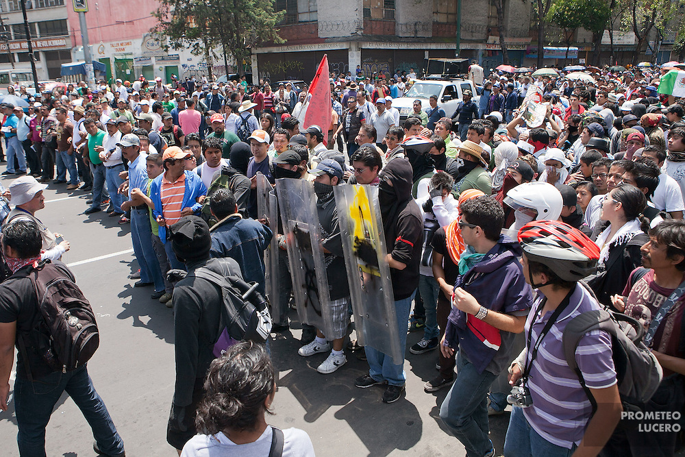 A group of masked activists who tried to arrive to San Lázaro Legislative Palace clashed with riot police, who maintained a strict encapsulation strategy, during protests against the first Presidential Inform, in Mexico City on September 1st, 2013. Unionized teachers from the National Coodinator of Education Workers (CNTE) stopped confrontations. 16 people were arrested, including 3 independent media journalists. (Photo: Prometeo Lucero)