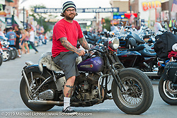 Noah Ogeen of Kahului (Maui) Hawaii on his 1958 Harley-Davidson UL Flathead  on Sturgis' Main Street during the annual Black Hills Motorcycle Rally. SD, USA. August 9, 2014.  Photography ©2014 Michael Lichter.