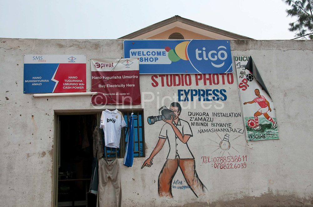 Rwanda 2014 Kigali. Shop selling phone cards, clothes and wall painting advertising  photo studio