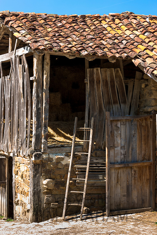 Old hay barn in mountain village of Somaniezo in Picos de Europa, Cantabria, Northern Spain