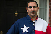 Mohamed Elibiary poses for a portrait outside his home in Plano, Texas on May 5, 2015.  (Cooper Neill for The New York Times)