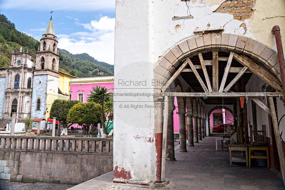 The Parroquia de San Simón Apostol on the Plaza de la Constitucion in Angangueo, Michoacan, Mexico. Angangueo is a tiny, remote mountain town and the entry point to the Sierra Chincua Monarch Butterfly Sanctuary.
