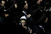 Ultra-Orthodox Jews attend the funeral of Abraham Wallace in Jerusalem's Mea Shearim neighbourhood, Israel.