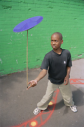 Young boy spinning plate in playground,