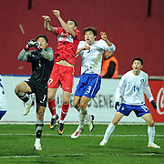 Turkey's Burak YILMAZ (C) and South Korean's goalkeeper Jung Sung-RYONG (L), Hwang Jae-WON (2ndR), Lee Jung-SOO (R) during their International friendly soccer match Turkey between South Korean at the Avni Aker stadium in Trabzon, Turkey on Wednesday 09 February 2011. Photo by TURKPIX