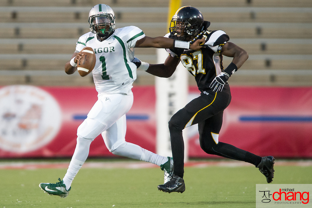 Vigor's Devin Adams (1)  attempts to escape from Williamson's Joshua Nix (87) during the first half of play at Ladd-Peebles Stadium Thursday, Sept. 13, 2012, in Mobile, Ala. At halftime Vigor leads Williamson 14-7. (Press-Register, Michael Chang) SPORTS