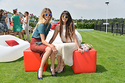 Left to right, JADE WILLIAMS and ZARA MARTIN at the Audi International Polo at Guards Polo Club, Windsor Great Park, Egham, Surrey on 26th July 2014.