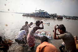 © under license to London News Pictures.  17/10/2010 ©London News Pictures. 17/10/2010. Devotees celabrate after carrying an idol of Hindu goddess Durga immersing it in the river Ganges on the last day of the Durga Puja festival on October 17, 2010 in Kolkata, India. The festival is the biggest of the year in the Indian state of Bengal and celebrates the worship of the Hindu Goddess Durga, who in Hindu Mythology is celebrated as the Goddess of power and the victor of good over evil.