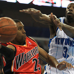30 January 2009: Golden State Warriors guard C.J. Watson (23) is defended by New Orleans Hornets forward Julian Wright (32) during a 91-87 loss by the New Orleans Hornets to Golden State Warriors at the New Orleans Arena in New Orleans, LA.