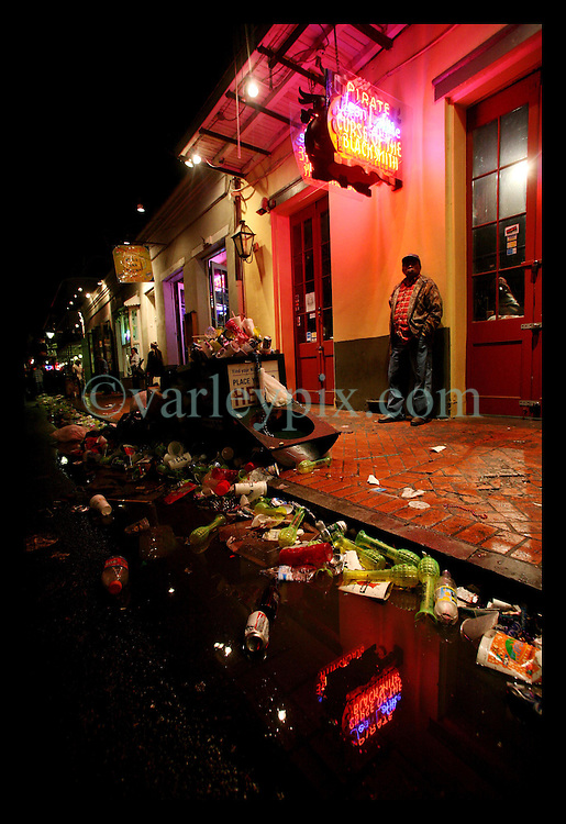 Feb 28th, 2006. New Orleans, Louisiana. Mardi Gras Day, Fat Tuesday, Bourbon Street. The party is over. Trash piled up in the street after Midnight, early in the morning of Ash Wednesday.