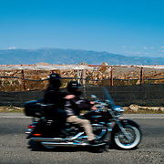 Blurred motion of biker riding bike