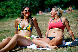 © Licensed to London News Pictures. 05/07/2017. London, UK. Georgie Rose and Eve Campbell sunbathe in Hampstead Heath in north London as temperatures hit 28C degrees on 5 July 2017. Photo credit: Tolga Akmen/LNP