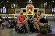 Bangkok, Thailand - June 14, 2017: Two young English women backpacking in Thailand wait at Hua Lamphong station in Bangkok for a night train to the north of the country.