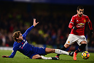 Henrikh Mkhitaryan of Manchester United (r) is tackled by Marcos Alonso of Chelsea .Premier league match, Chelsea v Manchester United at Stamford Bridge in London on Sunday 5th November 2017.<br /> pic by Andrew Orchard sports photography.
