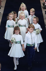 The bridesmaids and page boys, including Princess Charlotte (back left) and Prince George (back right) walk down the aisle following the wedding of Princess Eugenie and Jack Brooksbank at St George's Chapel in Windsor Castle.